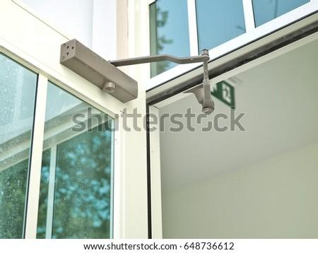 Door closer on white modern glass stock photo 648736612 shutterstock door closer on white modern glass door planetlyrics Images