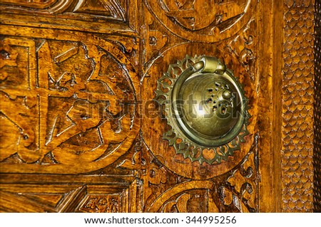 door handle and wooden carvings (18-19th cent.) - stock photo
