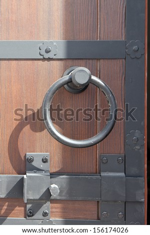 Door handle in the form of a ring - stock photo