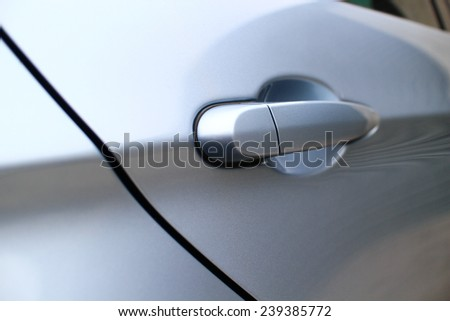 Door handle of a luxury sedan. - stock photo