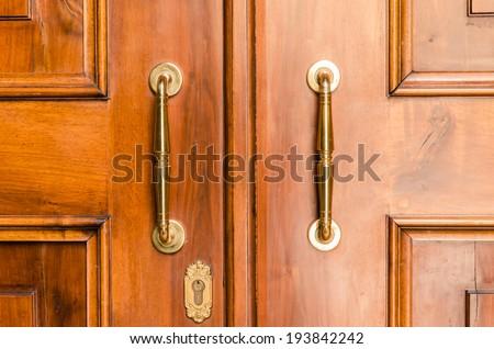 Door Handles With An Old Double Door.