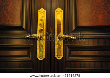Door handles with an old double door. - stock photo