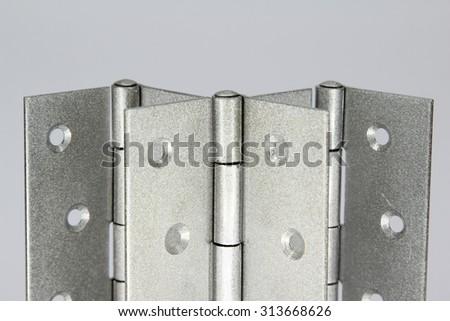 Door hinges isolated on white background. - stock photo