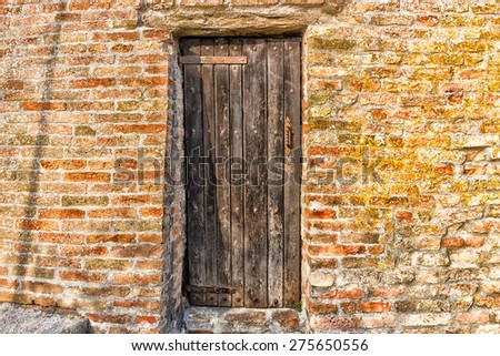 Door in the brick walls of the medieval Fortress of Venetians in Brisighella - stock photo