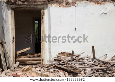 Door into a demolished house. - stock photo