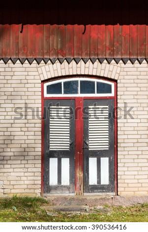 Door into the old barn - stock photo