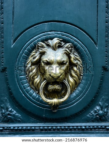 Door knocke - lion head - stock photo