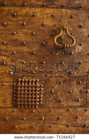 door knocker on old door with view rack in italy bologna - stock photo