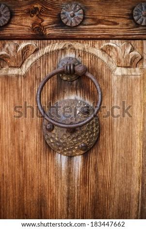 Door Knocker on the door of an old building - stock photo