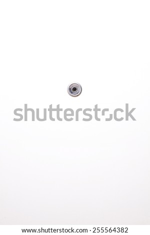 Door lens peephole on white wooden texture, closeup, fish eye, spyhole, with metal ring