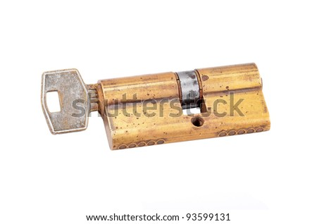 Door lock cylinder core with key, isolated on white background