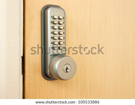 door lock with keypad outside laboratory room - stock photo