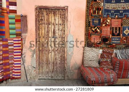 Door next to carpet shop in the Medina of  Marrakesh,Morocco - stock photo