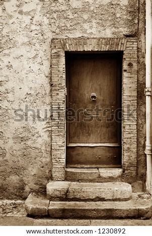 Door of a building in Antibes, France.  Sepia tone, high key.   Copy space. - stock photo