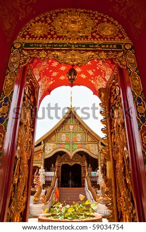 Door of church in Buddhist temple in north of Thailand