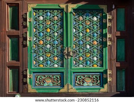 door of temple. close-up of the Geumsansa Temple door in South Korea - stock photo