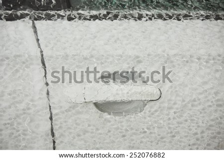 Door of the car covered by icy rain. - stock photo