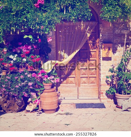Door of the Italian House Decorated with Fresh Flowers, Instagram Effect  - stock photo