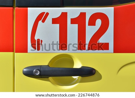 Door of vehicle with European Emergency Number 112. This public service is available in many European countries - stock photo