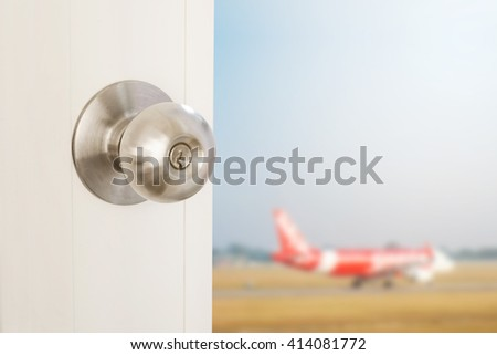 Door opening with blurred defocus airplane, concept of travel abroad, vacations and etc. - stock photo