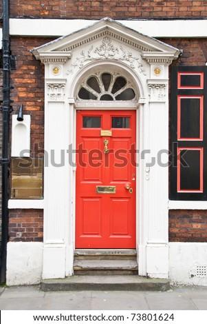 Door painted red. London - stock photo
