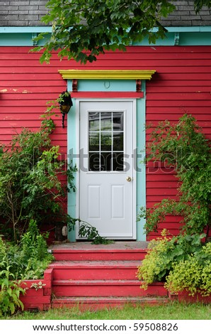 Door surrounded by foliage