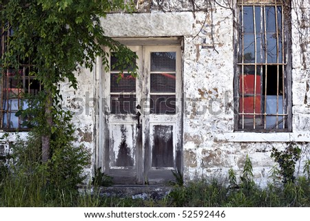 Door to old abandoned vintage retail store - stock photo