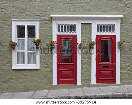 Doors and window of historical house in Quebec City - stock photo