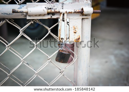 doors rusted iron fence - stock photo