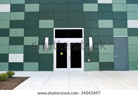 Doors with Green Block Building - stock photo