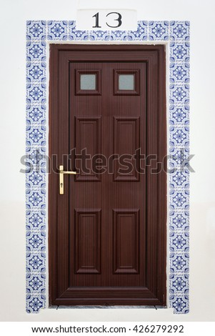 Doorway decorated with traditional Portuguese tiles - Azulejos, Algarve region, Portugal - stock photo