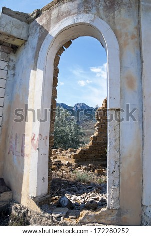 doorway in the ruins of the wall - stock photo
