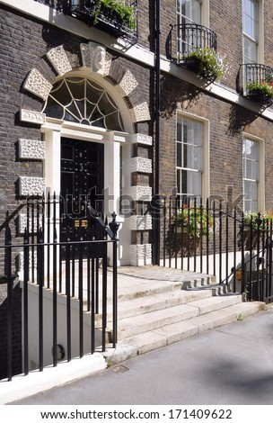 Doorway of 18th century Georgian period terraced house in London, UK. - stock photo
