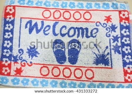 Doorway rug or doormat, welcome - stock photo