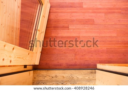 Doorway with open glass door leading onto luxury wooden porch shot from above showing rich wood colors and grain textures of porch hardwood flooring - stock photo