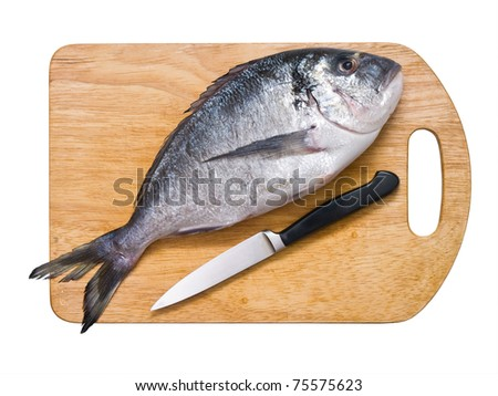 Dorado on wooden cutting board isolated on white - stock photo