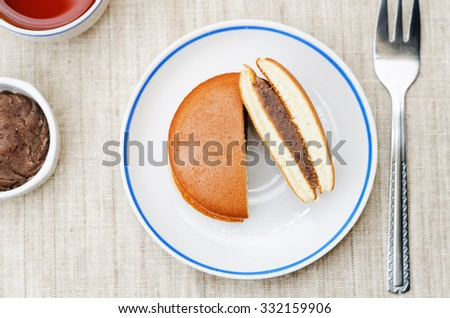 dorayaki, Japanese red bean pancakes on a light background. toning. selective focus