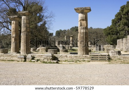 Doric columns of the ruins of a temple in ancient Olympia, the birthplace of the Olympic Games - stock photo