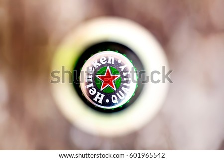 DORKOVO, BULGARIA - MARCH 13, 2017: Macro shot of Heineken bouttle flat lay view from above..Heineken Lager Beer is the flagship product of Heineken International