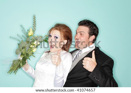 Dorky young couple on their wedding day - stock photo