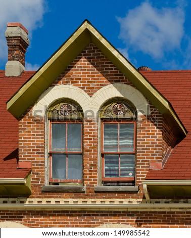 Dormer window on an old brick building - stock photo
