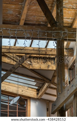 Dormer windows from inside. Architectural detail with old wooden dormer and windows. - stock photo