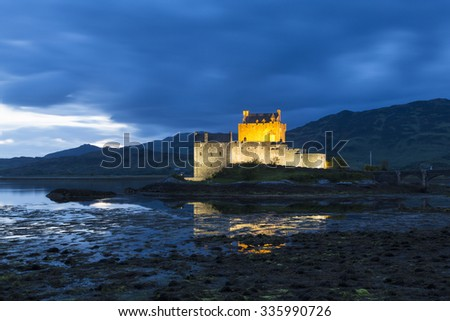 DORNIE, HIGHLAND/SCOTLAND - JUNE 09, 2014: Eilean Donan Castle on Loch Duich at illuminated at night. The castle was founded in the 13th Century during the reign of Alexander II.