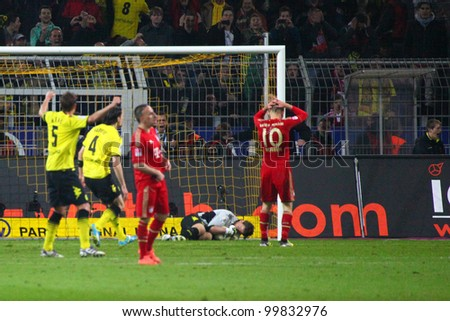 DORTMUND, GERMANY - APRIL 11: Arjen Robben misses a penalty, Weidenfeller (BVB) saves it during a Bundesliga match between BVB Dortmund & Bayern Munich, final score 1-0, on April 11, 2012, in Dortmund, Germany. - stock photo