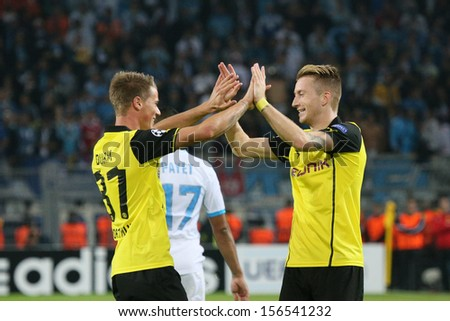 DORTMUND, GERMANY - OCT 1: Eric Durm  & Marco Reus (BVB) during a Champions League match between Borussia Dortmund & Olympique de Marseille, final score 3-0, on October 1, 2013, in Dortmund, Germany. - stock photo