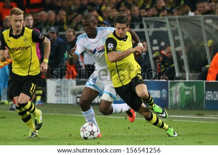 DORTMUND, GERMANY - OCT 1: Robert Lewandowski (BVB)  vs. Rod Fanni (Marseille) during a match between Borussia Dortmund & Olympique de Marseille on October 1, 2013, in Dortmund, Germany. - stock photo