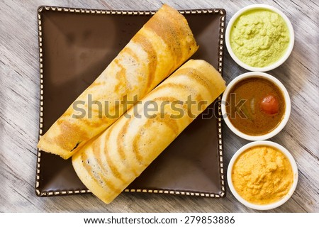 Dosa with Sambar and chutney, south Indian breakfast overhead view - stock photo