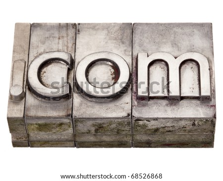 dot com internet domain extension in vintage grunge metal letterpress printing blocks, stained by color inks, isolated on white - stock photo