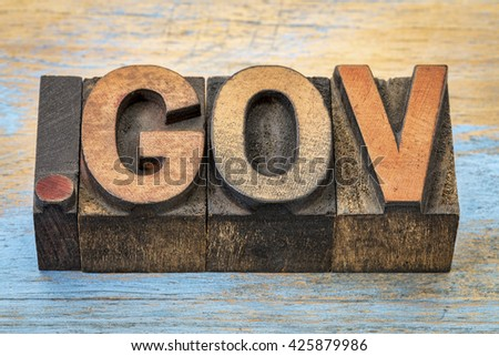 dot gov - government internet domain - text in vintage letterpress wood type blocks stained by color inks - stock photo