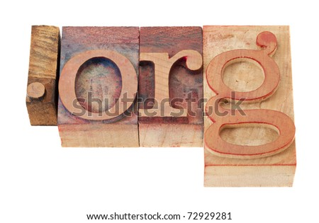 dot org - non-profit organization internet  domain extension in vintage wooden letterpress printing blocks, stained by color inks, isolated on white
